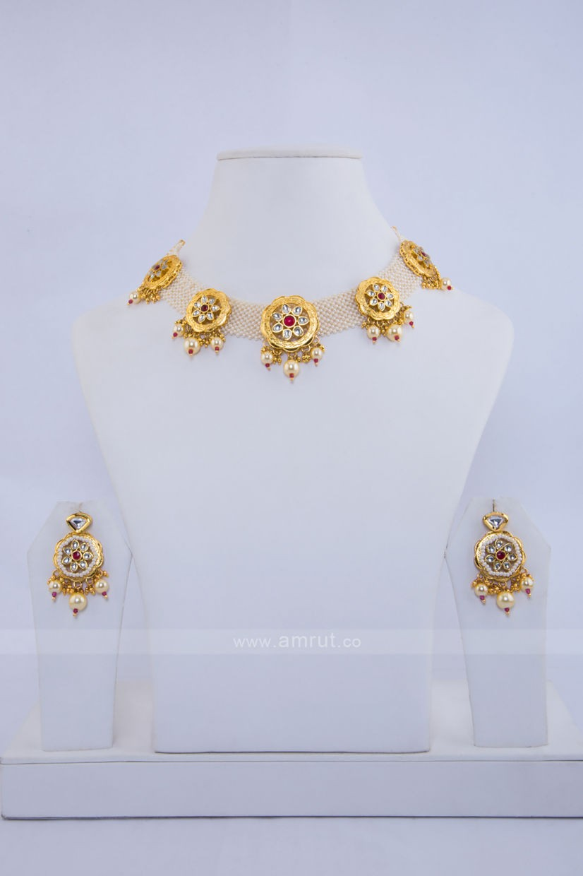 Skip to the beginning of the images gallery   Moti Choker Set Of Kundan With Beautiful Earrings